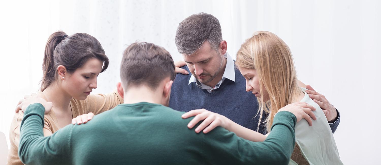 people praying in circle | Freedom House